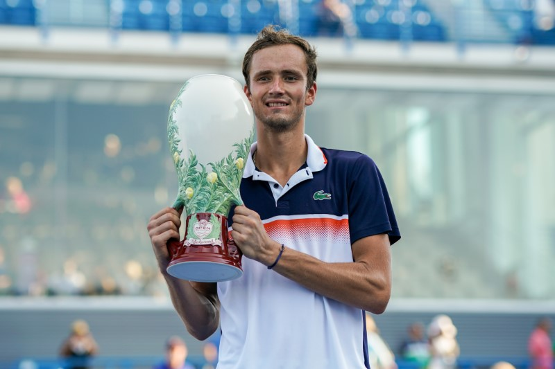 Aug 17, 2019; Mason, OH, USA; Daniil Medvedev (RUS) poses for a photo with the Rookwood Cup after defeating David Goffin (BEL) during the finals of the Western and Southern Open tennis tournament at Lindner Family Tennis Center. Mandatory Credit: Aaron Doster-USA TODAY Sports