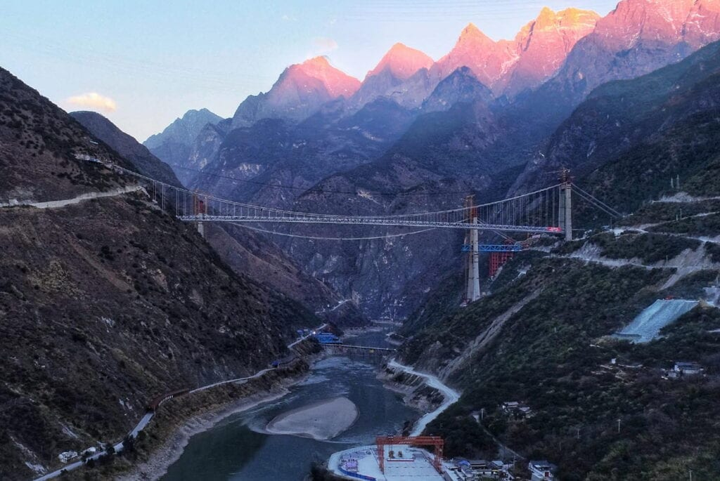 KUNMING (China):  Aerial view of the construction site of the Tiger Leaping Gorge Jinsha River Bridge in southwest China's Yunnan Province. The two sides of the bridge were joined together on Monday. With a total length of 1,017 meters, the bridge is a key project of the construction of the Shangri-La-Lijiang expressway.. Xinhua/ INP PHOTO