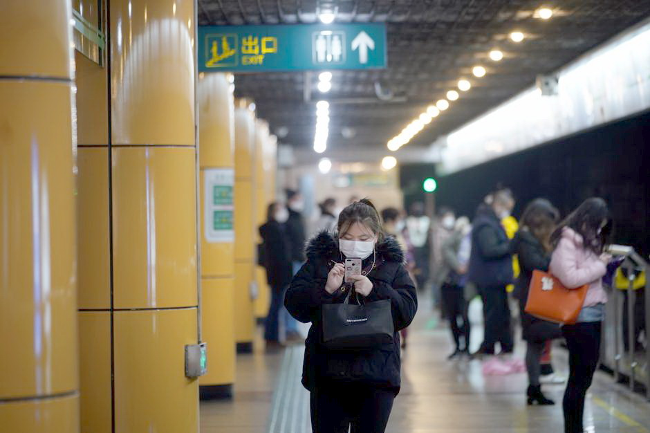 SHANGHAI People wear masks as they wait for their train at a subway station in China.
