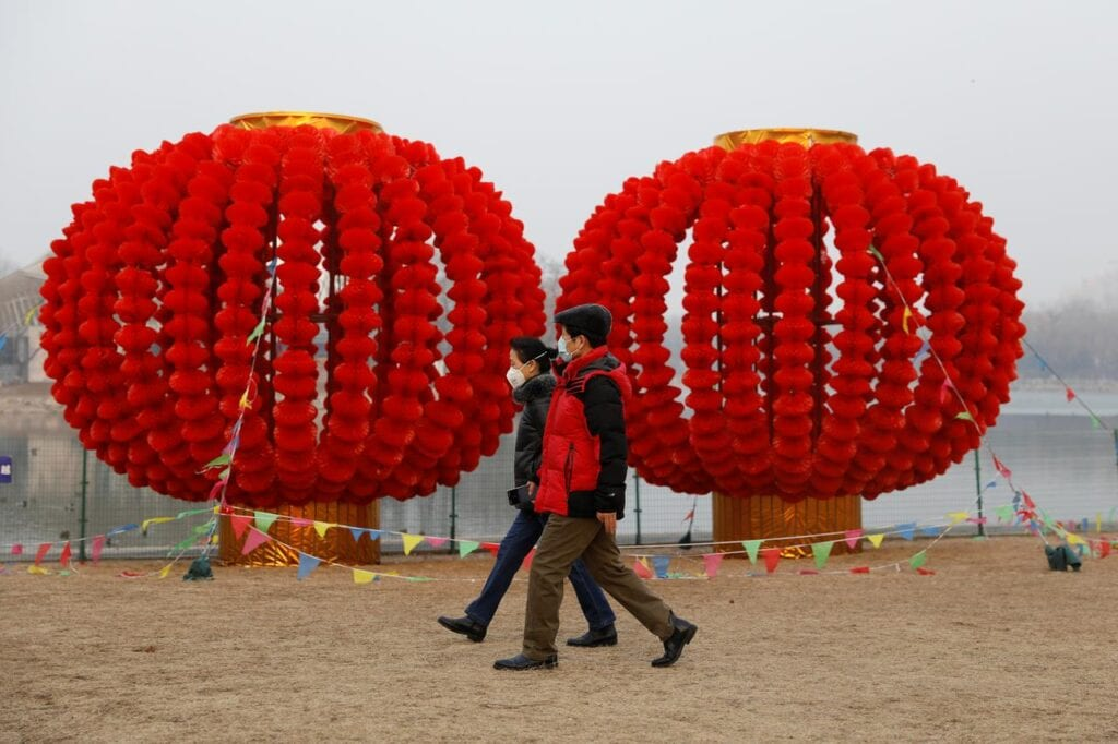 BEIJING People wearing face masks walk at Longtan Park, as the country is hit by an outbreak of the new coronavirus, in China.